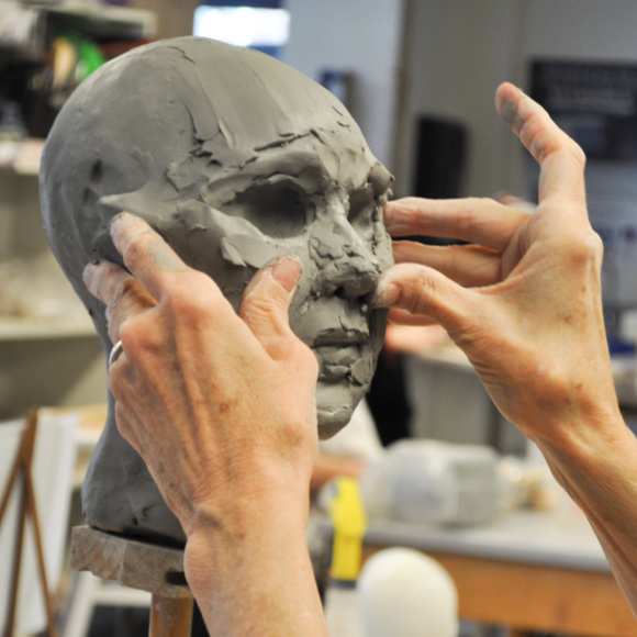 Class Image Sculpting a Portrait in Clay